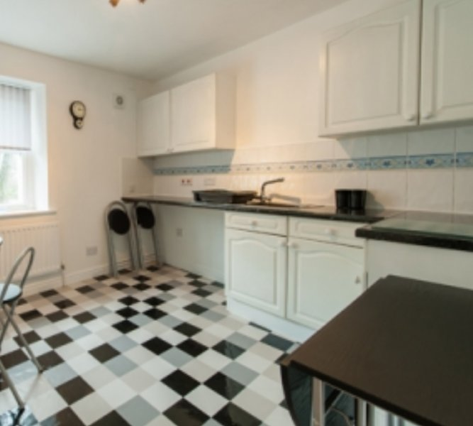 kitchenette, with fridge, toaster, seating area and  microwave.