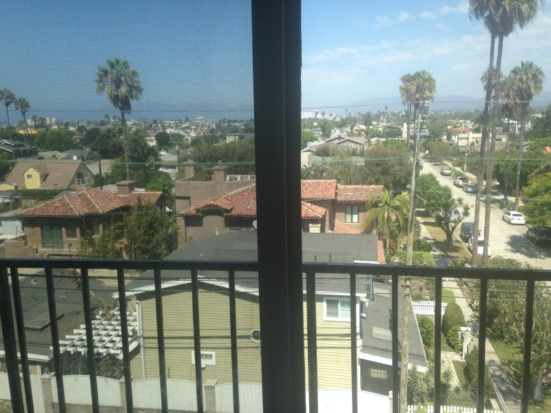 The view of the Venice Canal neighborhood and the Santa Monica mountains from the apartment.