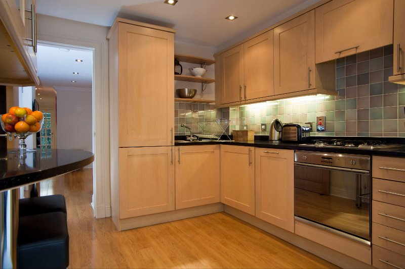 Fully fitted kitchen including fridge freezer, washer dryer, gas hob and breakfast bar.