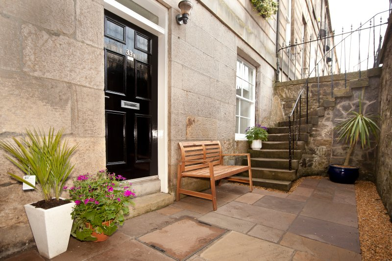 Main door into apartment with private patio.