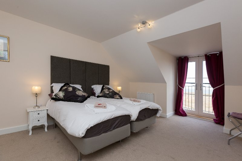 Master bedroom with sea-view from Juliette balcony, en-suite, TV/DVD, dressing table
