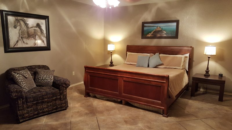 Master bedroom Lake side with a king bed