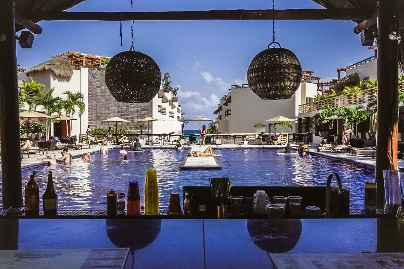 The Aldea Thai pool with swim up bar