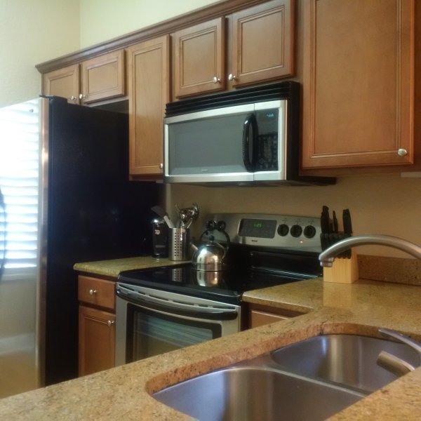 Granite countertops,  stainless steel appliances including dishwasher.