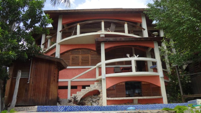 Front view of villa from over the pool deck. The master suite is on the upper level.