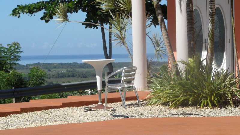 The house porch and the amazing valley and ocean view.