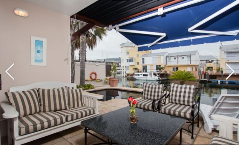 Patio / terrace area leading onto the splash pool and onto the waterfront canal with private mooring