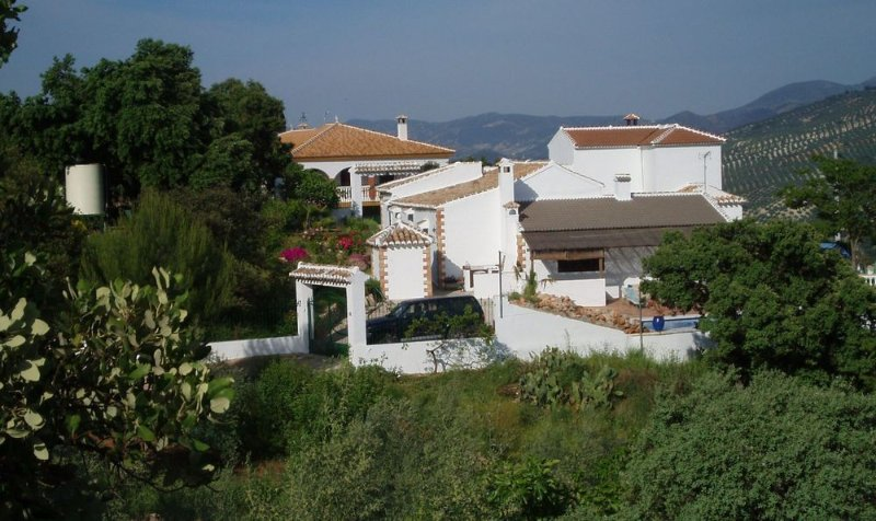 Finca Brigadoon with its beautiful surroundings and views across the olive groves and mountains.