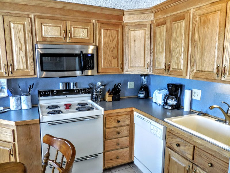Fully-equipped kitchen includes pots, pans and utensils