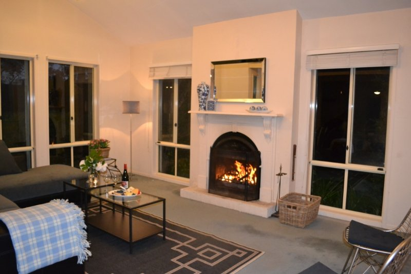 Formal Lounge Room with open fireplace where you can relax with friends and family, great view