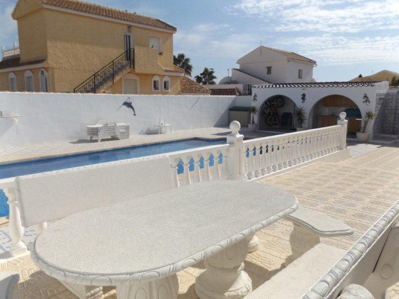 Patio area surrounding the swimming pool