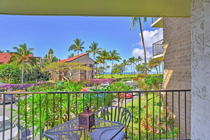 This Kihei vacation rental condo boasts ocean views from the private lanai.