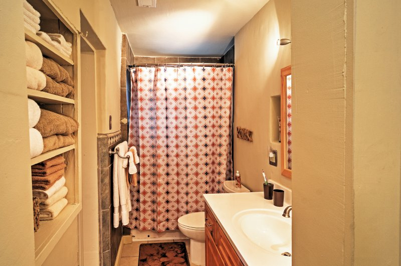 Rinse off the day in the first full bathroom.