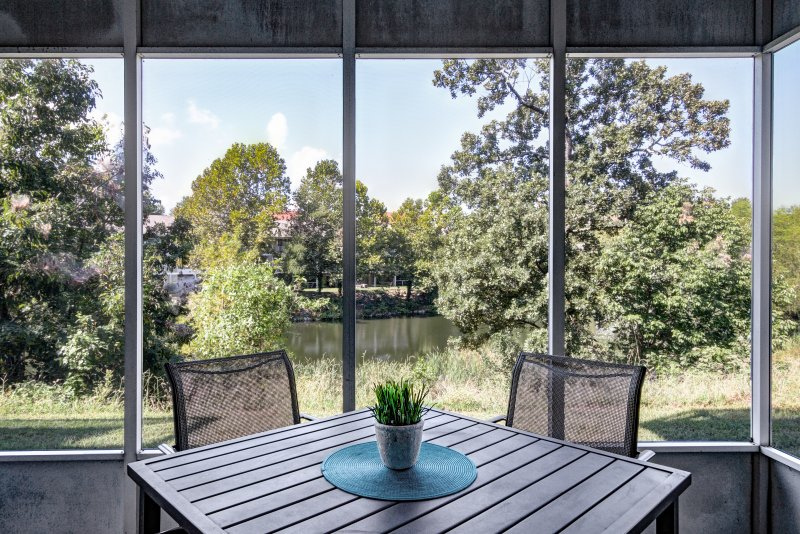 Enjoy a nice cup of coffee in the morning in your screened-in patio.