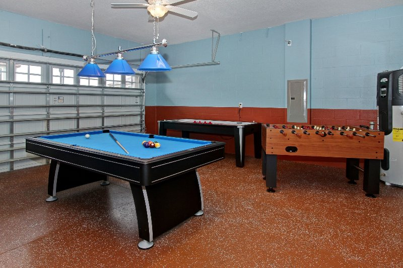 Game room with Pool table, foosball table and air hockey