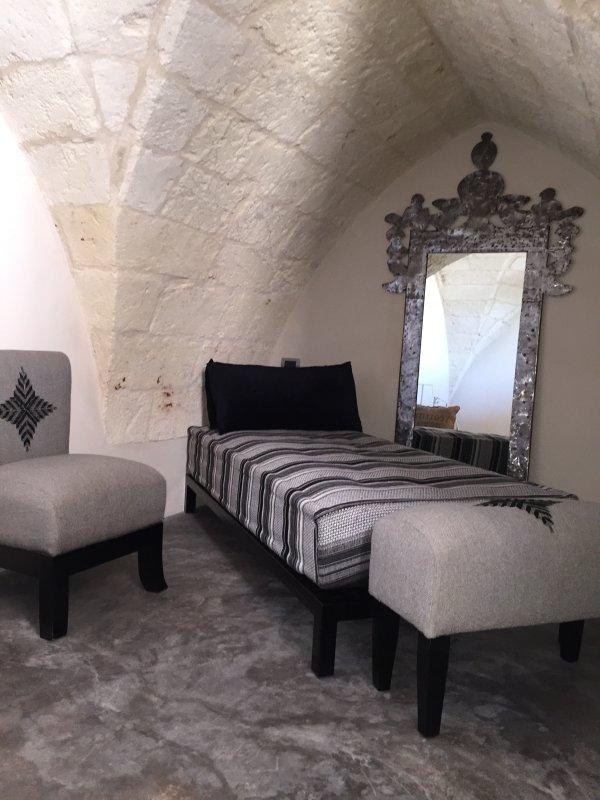 Donna Giovanna Suite: rum på övervåningen med de marockanska soffor