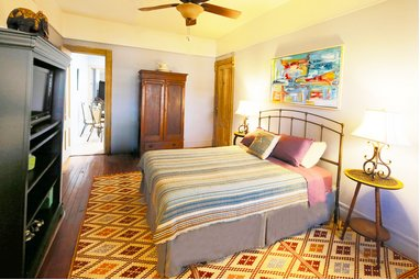 THE TWO BEDROOM FAMILY SUITE IS IDEAL FOR 4 PERSONS. THE BEDROOMS ARE SEPARATED BY AN EAT-IN KITCHEN