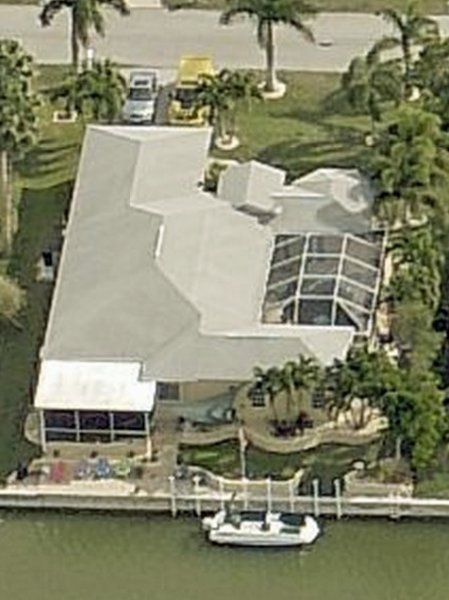 The small roofs on the top right are the Main entrance and the Pool house..