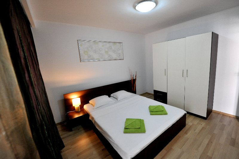 Double bed and large wardrobe in the bedroom.
