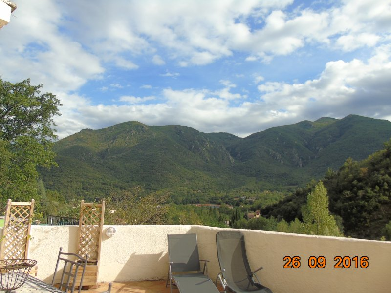 Enjoy breakfast on the terrace overlooking the mountains