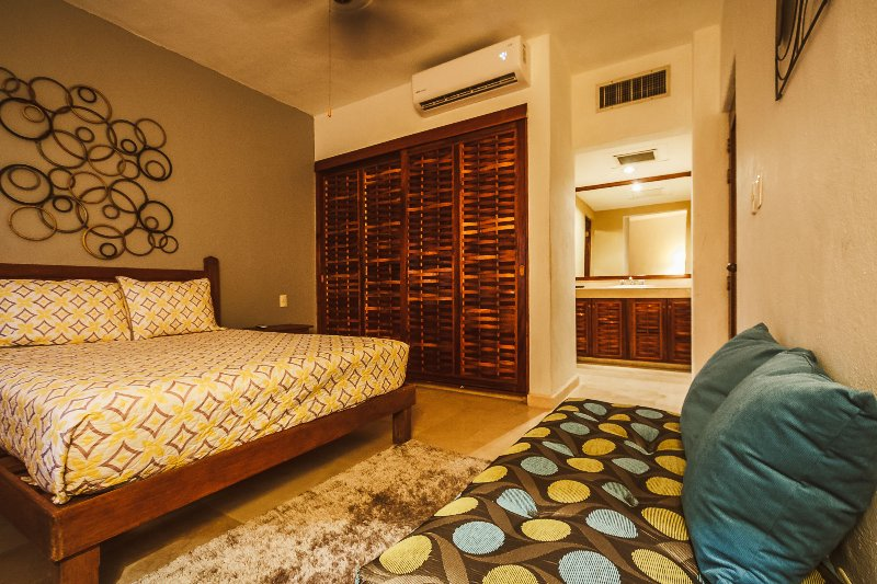 The master suite with queen bed and en suite bathroom