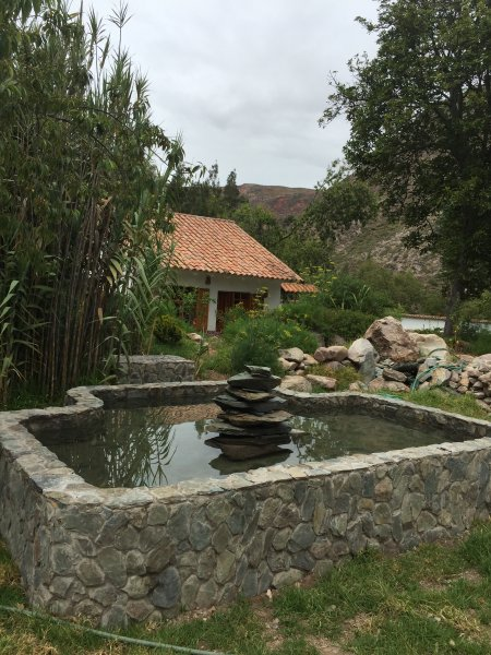 The Apacheta (offering to mother earth) fountain welcomes you to WIlkamayu (=Sacred River)