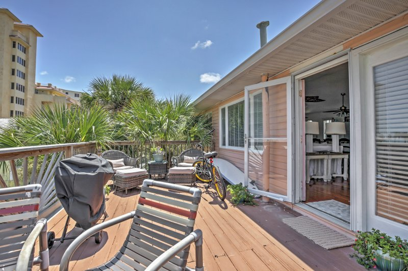 Sit out on the deck and get a tan at this 2-bed, 1-bath vacation rental home.