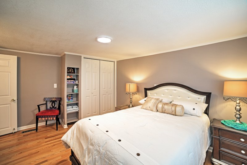 Cuddle up with your loved one in this spacious Queen-sized Bed.