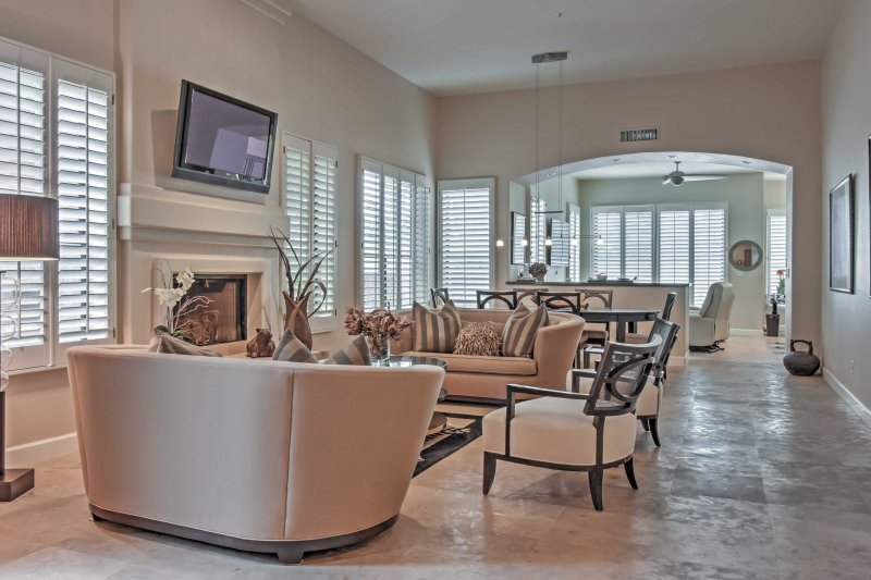 Relax in the living room and watch the flat screen TV.