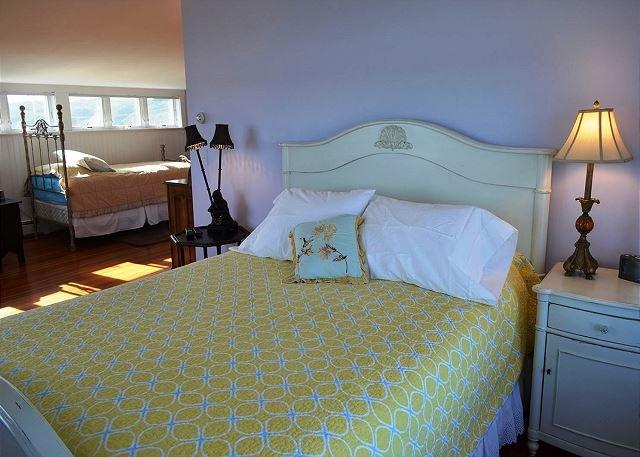 Third floor family suite queen bed.