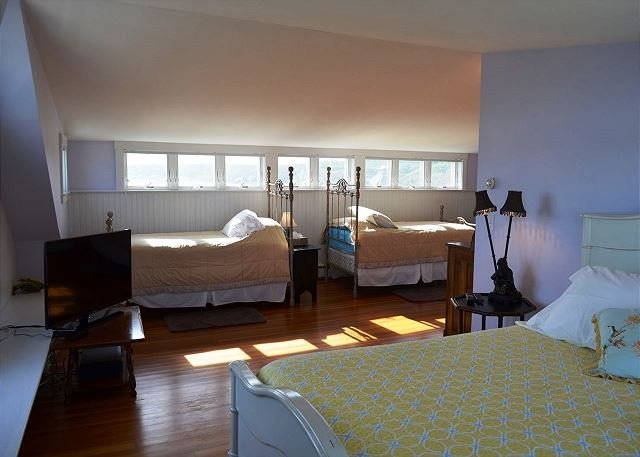 Third floor family suite with two twins and queen bed.
