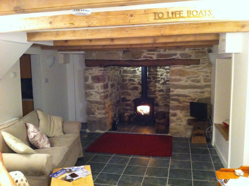 Inglenook fireplace with Bread Oven and Log burning stove.