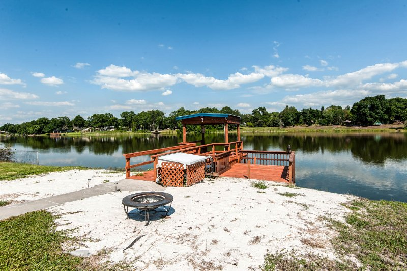 Be on water and centrally located to all the fun, holiday rental in Gibsonton