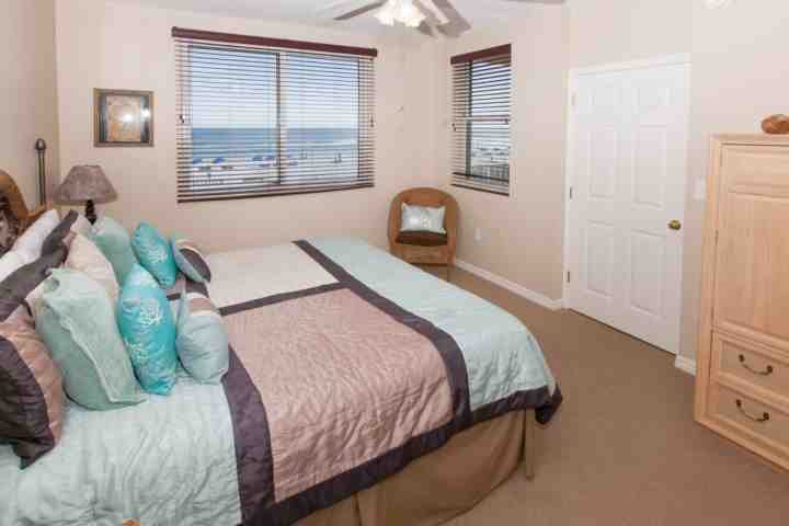 Master bedroom with sitting area and Gulf view