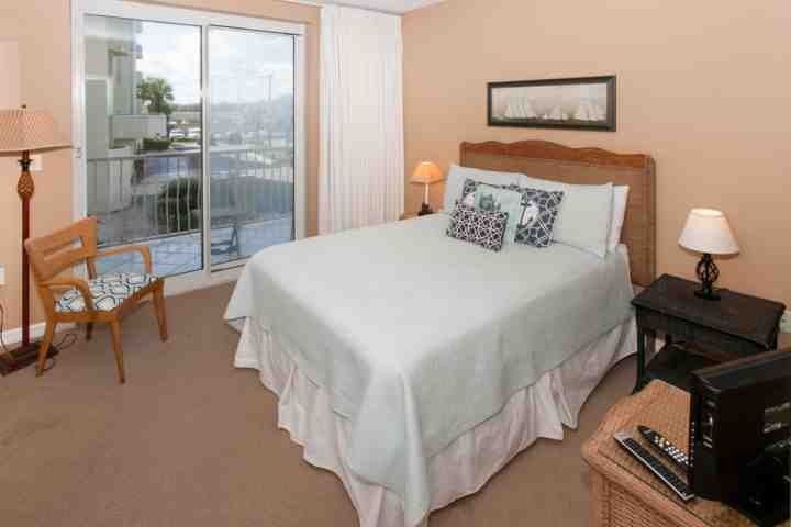 Guest room with sliding glass door to private balcony