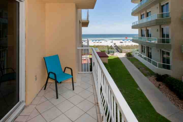 Wrap around balcony with lounging area and view of the beach and the Gulf