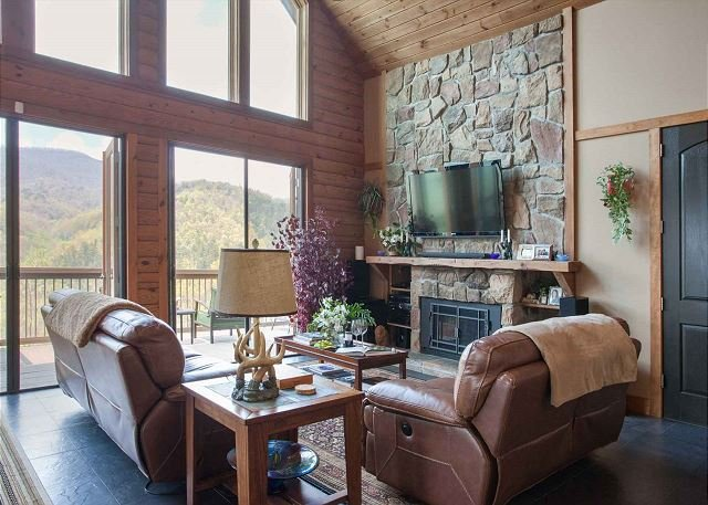 Living room with gas logs, stunning views and satellite TV