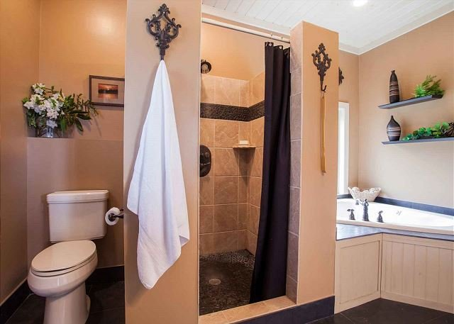 Full bath adjoining owner's suite; shower and Jacuzzi tub