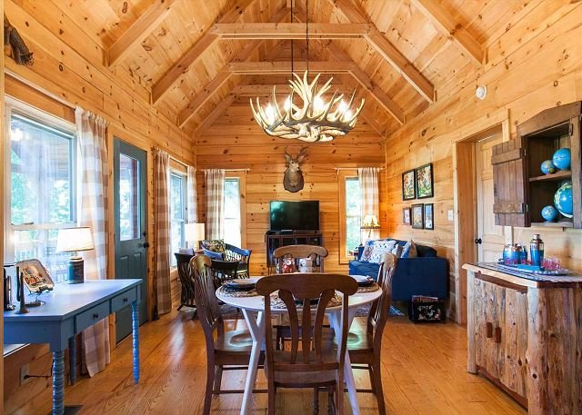 Gorgeous, high, beamed ceiling in dining area and den.