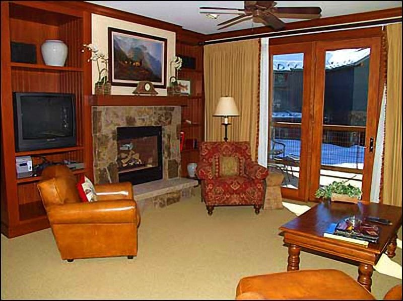 Lavishly Appointed living room with Gas Fireplace and Views