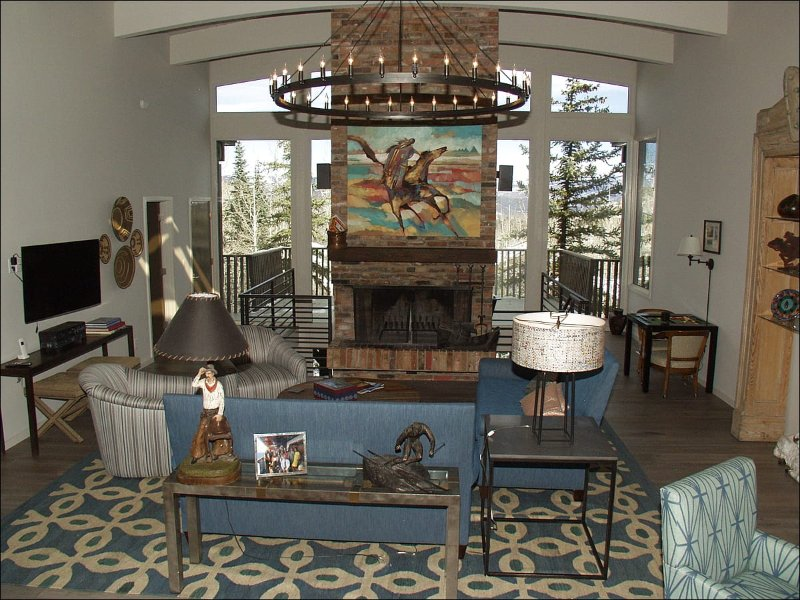 Large living room with brick fireplace and views!