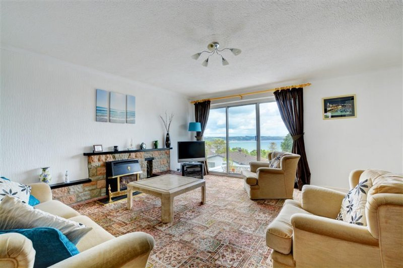 Light spacious lounge with patio doors to sun terrace area with sea views
