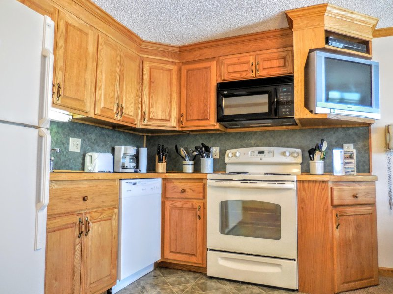Remodeled kitchen is fully-equipped with pots, pans & utensils