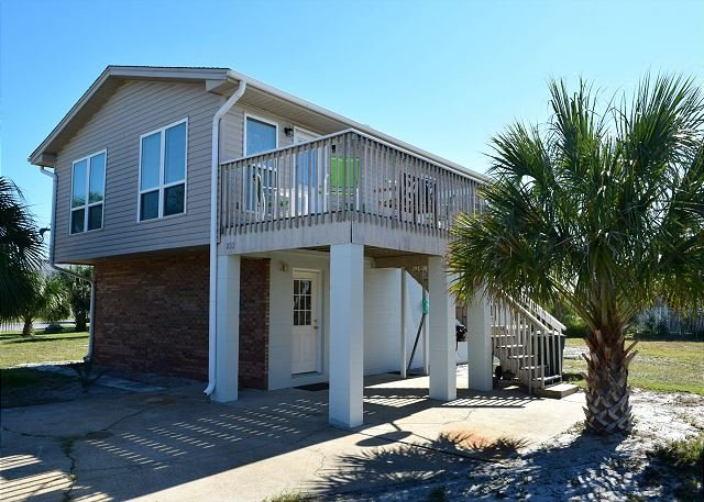 This island view home has a great deck and is just a short walk to either the sound of the gulf.