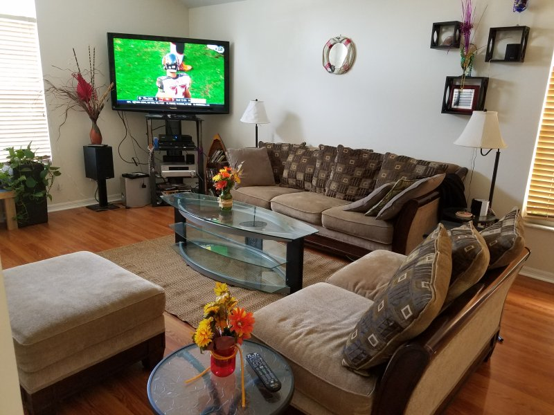 Living/Family room with 55 inch TV.  Cable and WiFi