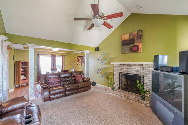 Family Room. Beautiful vaulted ceilings. Two reclining couches. TV with cable.