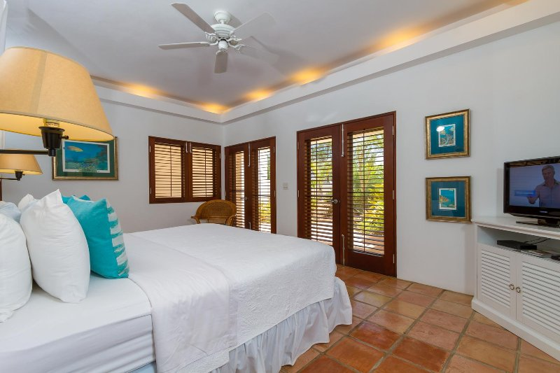 The Gardner Master Suite features French doors that open onto the tropical garden and flat screen TV