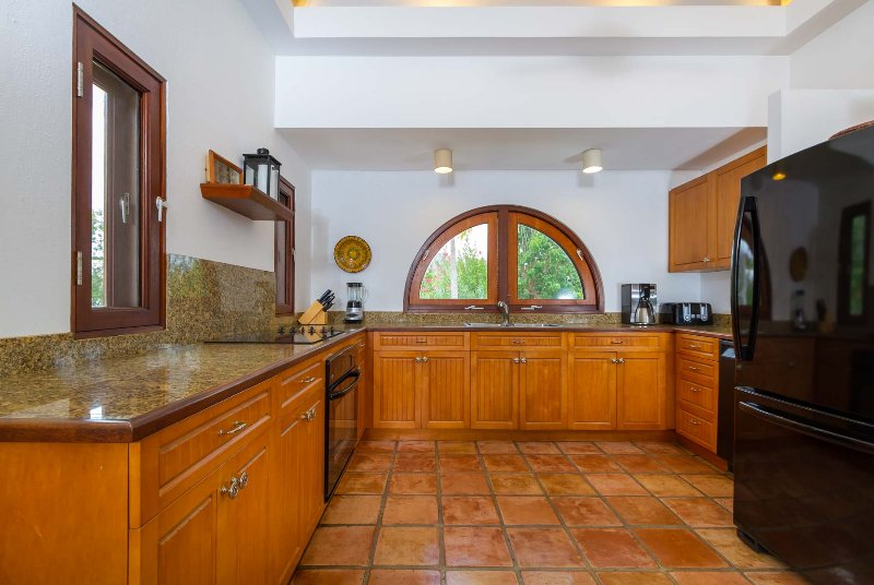 Coconut Palm Villa features a fully equipped granite counter kitchen w/ state-of-the-art appliances