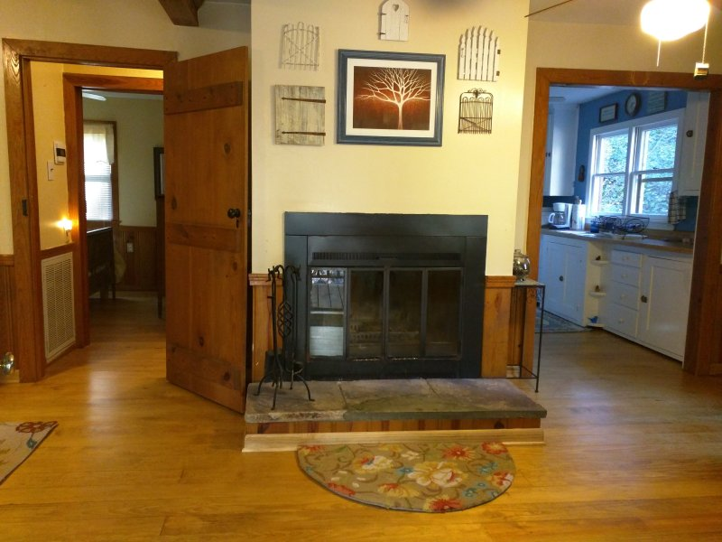 The fireplace in the heart of the cabin and  new hardwood floors throughout add warmth and comfort.