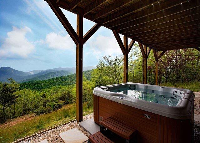 Lower level patio w/ hot tub
